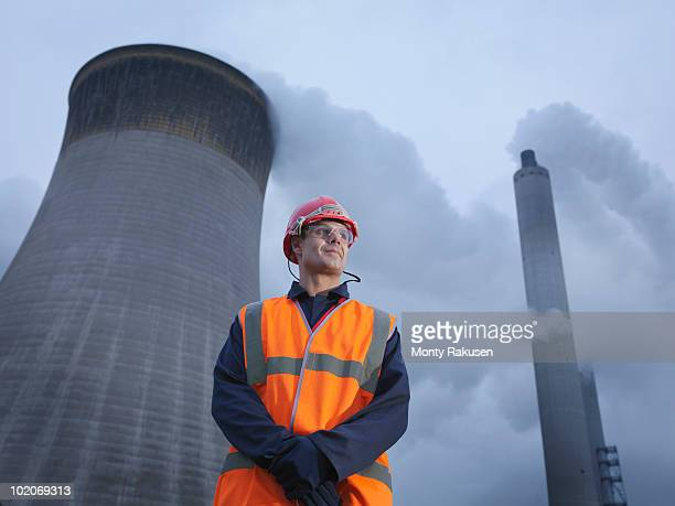 worker with coal fired powerstation - monty rakusen stock pictures, royalty-free photos & images