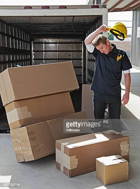 Worker With Damaged Boxes