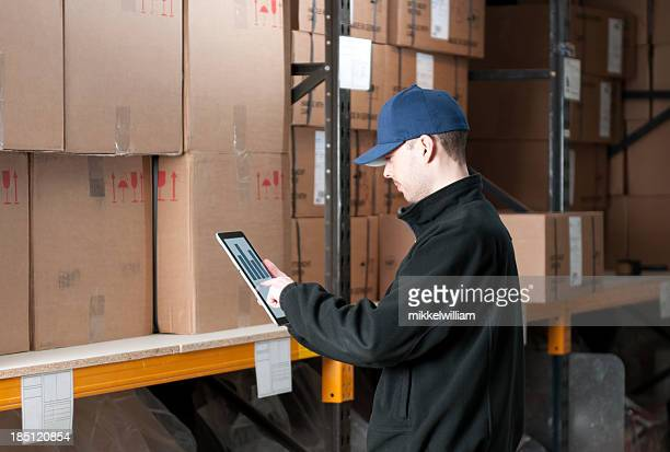 Worker with digital tablet in warehouse