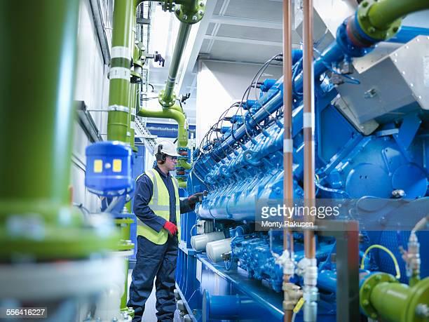 worker with gas fired generator in gas fired power station - monty rakusen stock-fotos und bilder