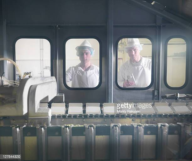 worker with goat's milk in dairy - milk carton stock photos and pictures