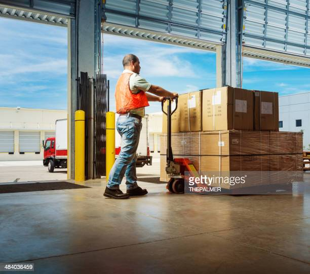 worker with hand pallet truck - box container stock pictures, royalty-free photos & images