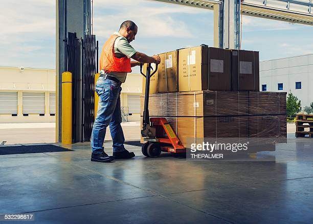 worker with hand pallet truck