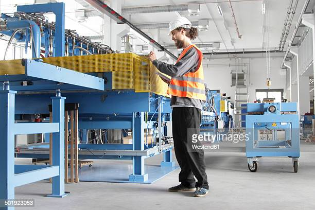 worker with hard hat in a factory hall - baden württemberg stock photos and pictures