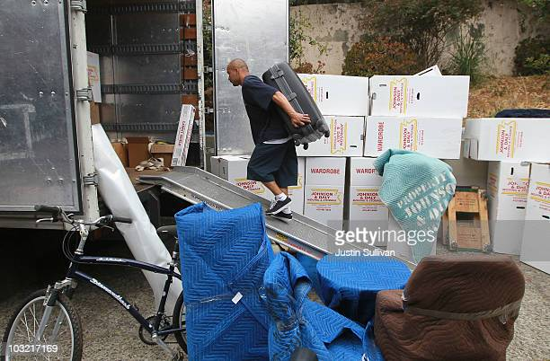 A worker with Johnson and Daly Moving and Storage moves a piece of furniture into a truck while moving a family August 3 2010 in Tiburon California...