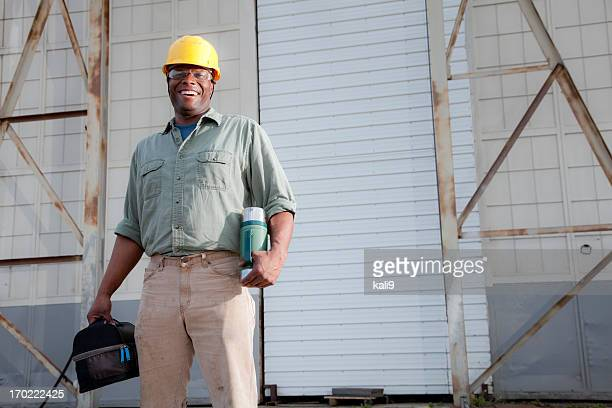 Worker with lunchbox