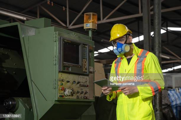 a worker with protective gas mask in factory industrial area - air respirator mask stock pictures, royalty-free photos & images