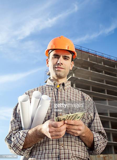 Worker with salary in the hands