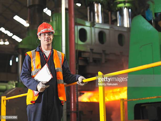 worker with steel forge - steelmaking stock photos and pictures