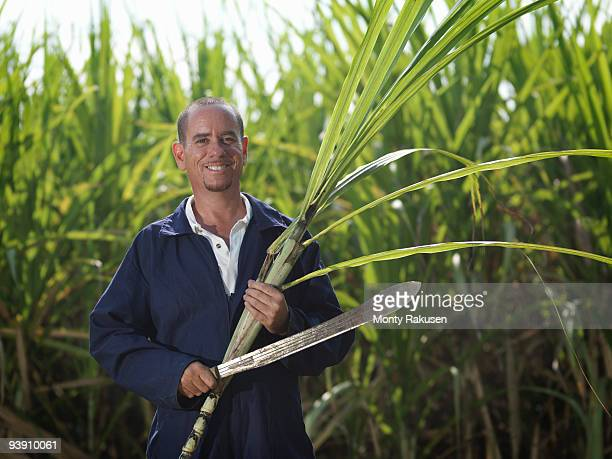 Worker With Sugar Cane And Machete