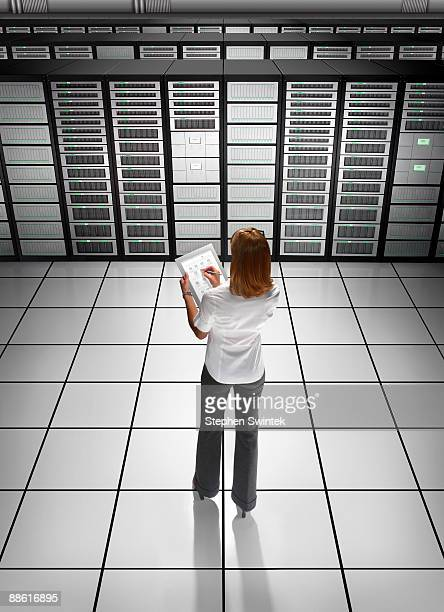 IT worker with tablet in server room