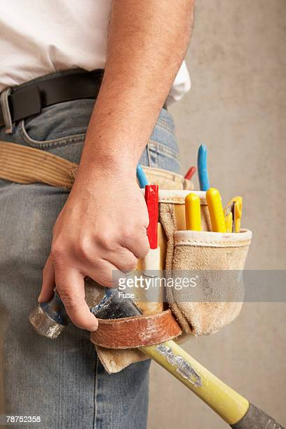 worker with tool belt - percussion mallet stock pictures, royalty-free photos & images