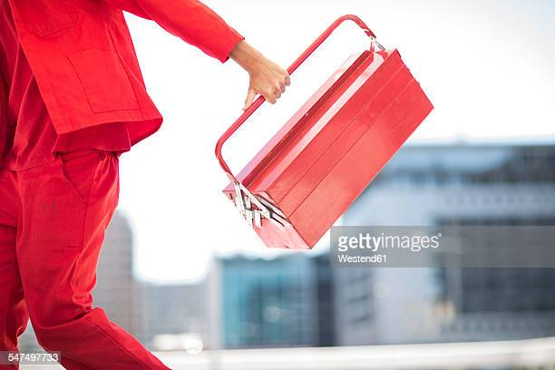 worker with tool box dressed in red - toolbox stock photos and pictures