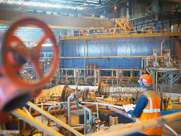 worker with turbines in power station - monty rakusen stock photos and pictures