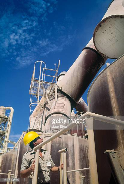 Worker with yellow helmet at cement factory