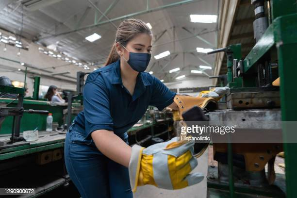 worker working at a shoe factory wearing a facemask - shoe factory stock pictures, royalty-free photos & images