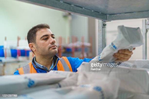 worker working in warehouse - participant stock pictures, royalty-free photos & images