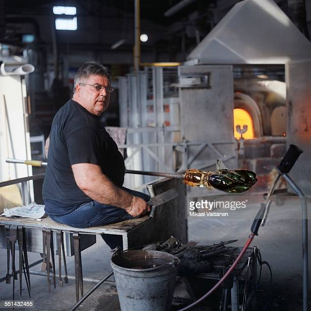 worker working on glass - murano stock pictures, royalty-free photos & images