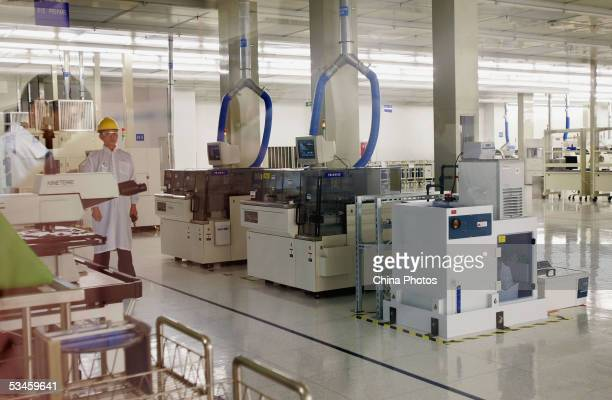 Worker works at the Intel Assembly and Test Factory on August 24, 2005 in Chengdu of Sichuan Province, China.The 400-million-dollar project, the...