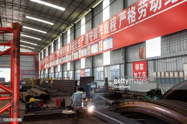 A worker works on steel in a warehouse at the site for the Luang Prabang railway bridge a section of the ChinaLaos Railway built by the China Railway...