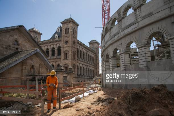 """Worker works on the construction site of a concrete """"arena"""" on the historic site of the Queen's Palace in Antananarivo on May 22, 2020."""