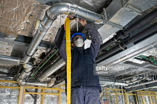 worker wrapping an hvac air duct with foil tape - ventilator stock pictures, royalty-free photos & images