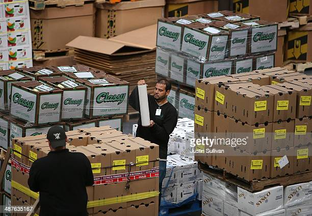 A worker wraps a pallet of donated produce at the SFMarin Food Bank on May 1 2014 in San Francisco California Food banks are bracing for higher food...