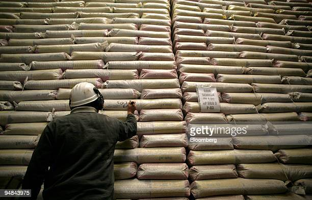 A worker writes the origin date on bags of soybean seeds at the Ferias del Norte factory in Salto Argentina on Tuesday April 29 2008 Argentine...