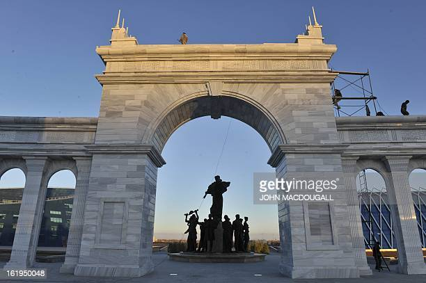 Workers add finishing touches to a marble arch part of the Kazakh Eli National Monument in Kazakhstan's capital Astana October 12 2010 The monument...