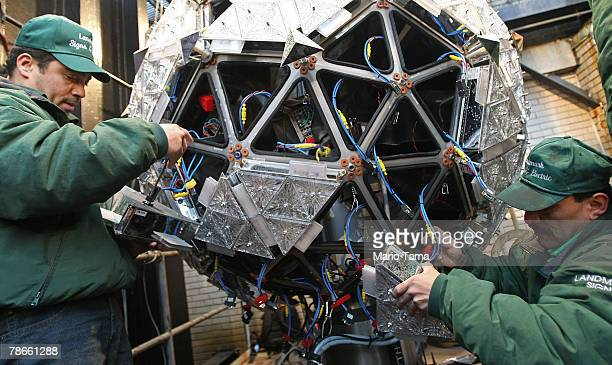 Workers add Waterford Crystal panels to the ball that will be dropped on New Year's Eve in Times Square December 27 2007 in New York City The newly...