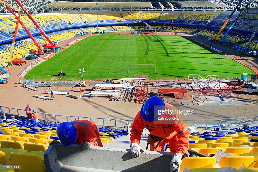 Workers adjust new seats at Estadio Municipal de Concepción Alcaldesa Ester Roa Rebolledo is seen during restoration prior to Copa America Chile 2015 at Concepcion, Chile on April 17, 2015.