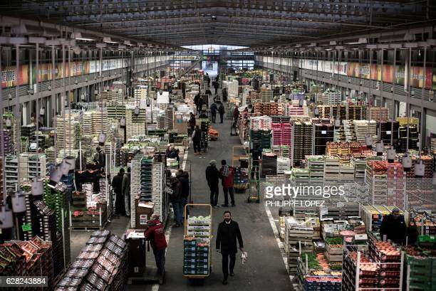 Workers and buyers are seen at the fruits and vegetables pavilion of the Rungis international food market in Rungis a southern suburb of Paris on...