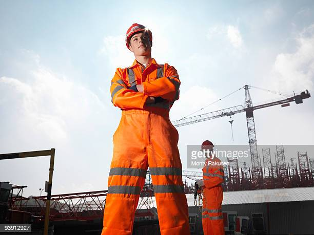 Workers And Cranes