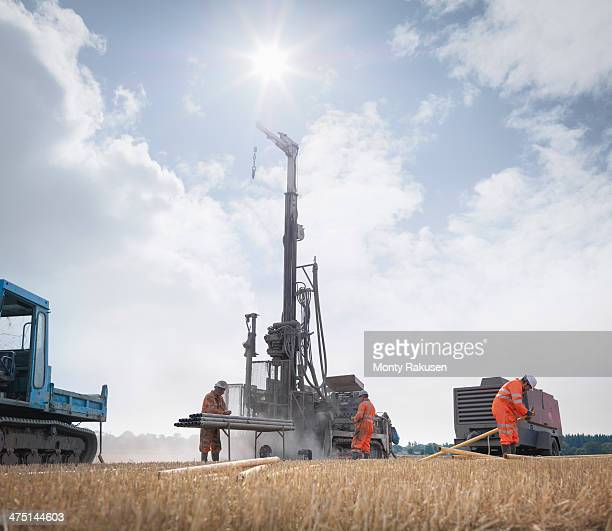 workers and drilling rig exploring for coal in field - モーペス ストックフォトと画像