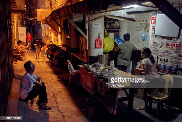Workers and employees continue to do their trade on the streets of Manila's Chinatown as government allows on September 16, 2021 in Manila,...