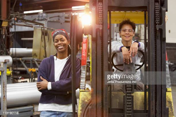Workers and forklift in factory
