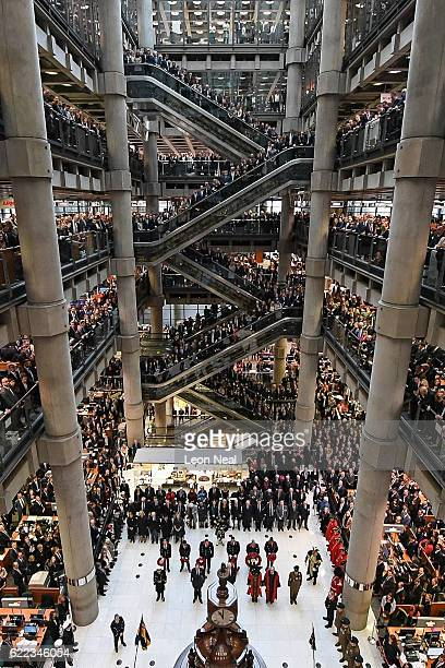 Workers and guests mark the two minute silence for Armistice Day in the Lloyd's Building on November 11 2016 in London England People gathered at war...