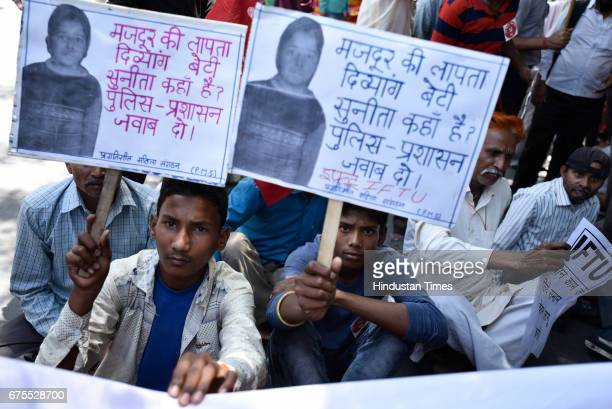 Workers and labourers holding placards as they participate in a May Day protests against Prime Minister Narendra Modi and the central government at...
