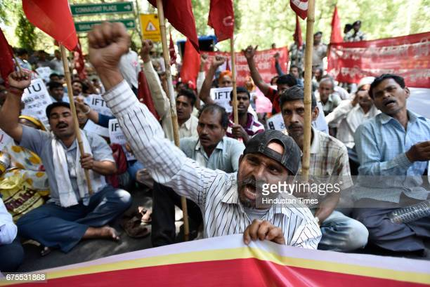 Workers and labourers shouting slogans against Prime Minister Narendra Modi and the central government during May Day rally at Jantar Mantar on May 1...