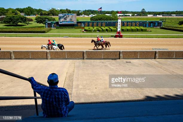 Workers and owners wait for the start of the 5th Race with no fans in the stands during the Covid19 Pandemic on Derby Day at Oaklawn Racing Casino...
