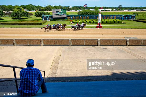 Workers and owners watch the start of the 5th Race with no fans in the stands during the Covid19 Pandemic on Derby Day at Oaklawn Racing Casino...