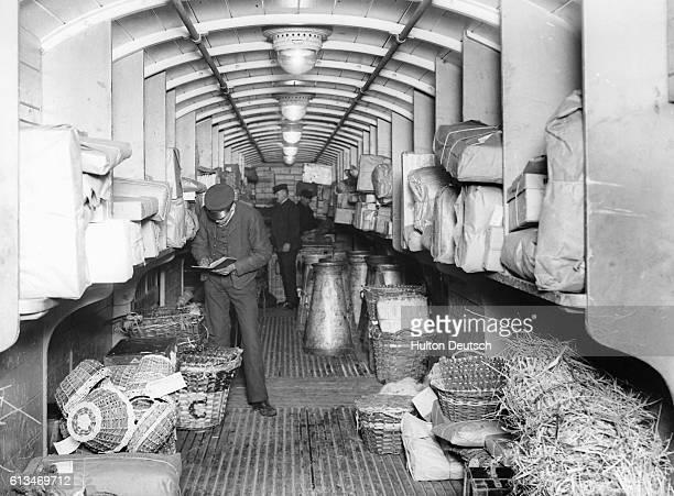 Workers and packages inside Great Western Railway's parcel train van 1912