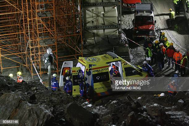 Workers and rescuers gather on November 7 2009 in Massana near AndorrelaVielle in Andorra at the construction site where a bridge collapsed killing...
