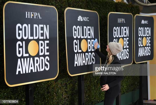 Workers and staff prepare the red carpet area for Sunday's the 76th Golden Globe Awards at the Beverly Hilton hotel in Beverly Hills California on...