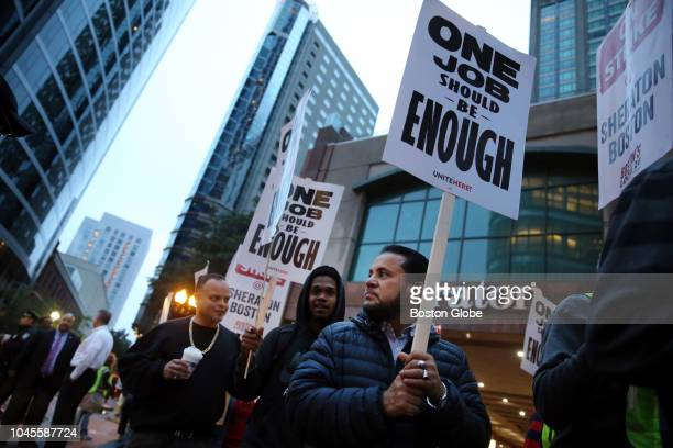 Workers and supporters picket outside the Sheraton Boston by Marriott in Boston on Oct 3 2018 Hotel workers walked off the job at seven Marriott...