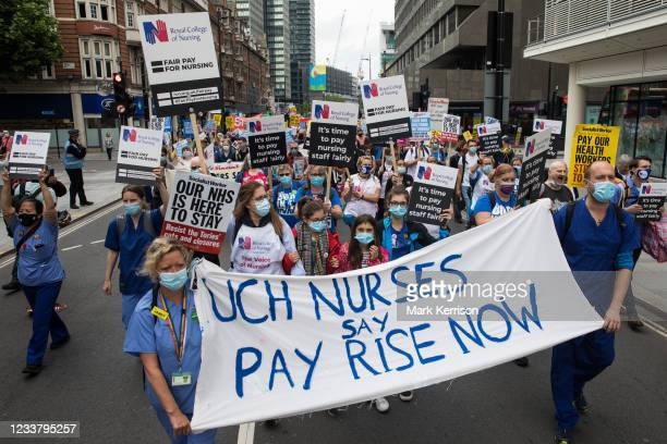 Workers and supporters take part in a protest march from University College Hospital to Whitehall as part of a national day of action to mark the...