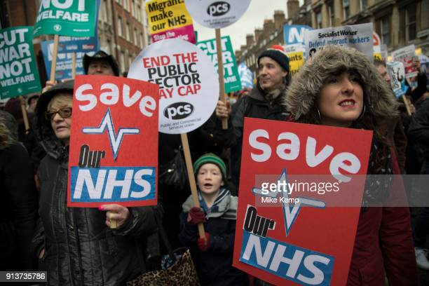 NHS workers and the public join a mass protest demonstration to save the NHS on 3rd February 2018 in London United Kingdom The NHS faces the threat...