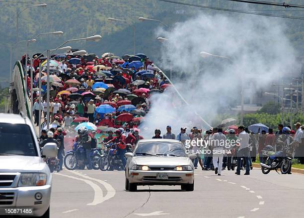 Workers and users of the stateowned Empresa Nacional de Energia Electrica march demanding to the government not to expand the contracts with the...
