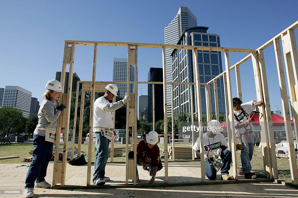 Workers and volunteers help to build a house for Habitat for