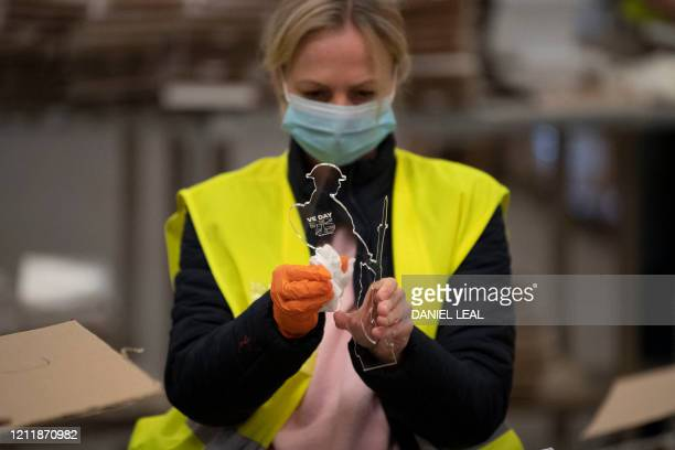 Workers and war veterans wearing PPE of a face mask as a precautionary measure against COVID19 social distance as they assemble and prepare for...